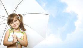 Little girl child with umbrella. On sky background Royalty Free Stock Photo