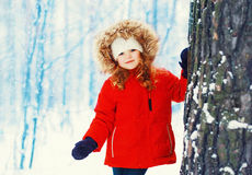 Little girl child walking in snowy winter Stock Photos