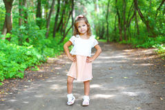 Little girl child wearing a dress in summer Stock Image