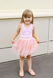 Little girl child wearing a pink skirt outdoors Stock Photography