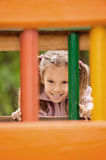 Little girl on children's playground. Stock Photo