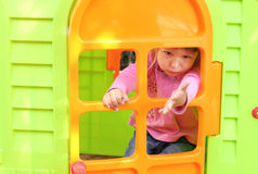 Little girl with a children's playhouse Royalty Free Stock Photos