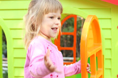 Little girl with a children's playhouse Royalty Free Stock Photography