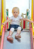 Little girl on the children's slide Stock Images