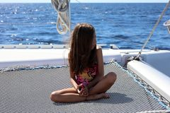 Little girl children sailing in catamaran at Los Cabos Mexico. In the sea ocean pacific water happy girl Royalty Free Stock Images