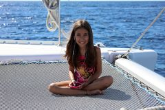 Little girl children sailing in catamaran at Los Cabos Mexico. In the sea ocean pacific water happy girl Royalty Free Stock Photo
