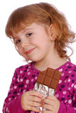 Little girl with chocolate Stock Images
