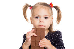 Little girl with a chocolate bar Royalty Free Stock Images