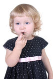 Little girl with chocolate candy Stock Photography