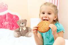 Little girl with chocolate chip cookies Royalty Free Stock Photo