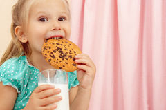 Little girl with chocolate chip cookies and milk Stock Photography