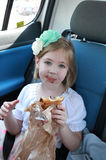 Little girl with chocolate covered mouth Royalty Free Stock Image