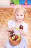 Little girl with  chocolate egg Royalty Free Stock Photography