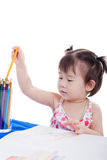 Little girl choosing colour pencil for draw picture Stock Images
