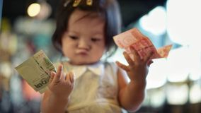 Little girl choosing money which one to use royalty free stock photography