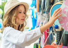 Little girl is choosing table tennis racket. Royalty Free Stock Images