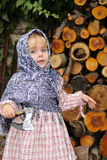 The little girl  chops firewood an axe Stock Photos
