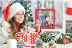 Little girl with Chrismas present Royalty Free Stock Photo