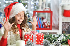 Little girl with Chrismas present Stock Photo