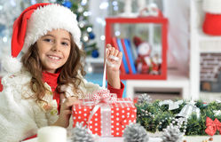 Little girl with Chrismas present Stock Image