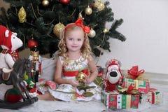 Little girl in Christmas Stock Image