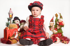 Little girl in christmas atmosphere Stock Photos