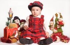 Little girl in christmas atmosphere stock photos