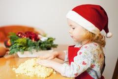 Christmas baking. Little girl at christmas bakery stock images