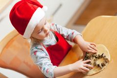 Little girl at christmas bakery royalty free stock image