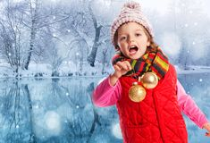 Little girl with christmas balls Royalty Free Stock Photos