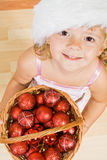Little girl with christmas balls Royalty Free Stock Photography