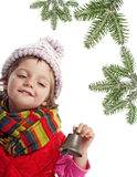 Little girl with christmas bell and spruce tree Royalty Free Stock Photos