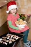 Little girl and Christmas cookies Stock Image