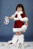 Little girl in Christmas costume with glass ball Royalty Free Stock Image