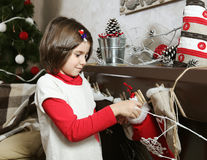 Little Girl with Christmas Decorations Stock Photos