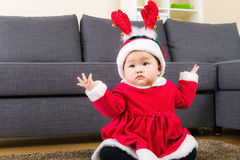 Little girl with christmas dressing Stock Images