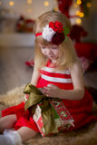 Little girl at christmas Eve Stock Photos