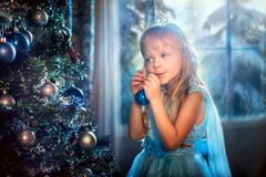 Little girl at Christmas Eve royalty free stock images