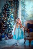 Little girl at Christmas Eve stock photo