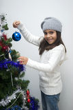 Little girl and christmas fir Royalty Free Stock Photo