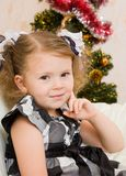 Little girl at a Christmas fir-tree. Royalty Free Stock Images
