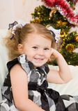 Little girl at a Christmas fir-tree. Royalty Free Stock Photography