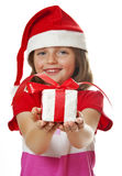 Little girl with christmas gift Royalty Free Stock Image