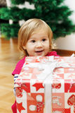 Little Girl with a Christmas Gift Stock Image