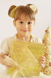 Little girl with Christmas gift Stock Image