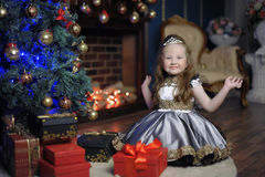 Little girl at Christmas with a gift Royalty Free Stock Image