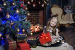 Little girl at Christmas with a gift Royalty Free Stock Photo