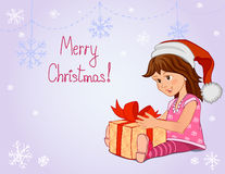 Little girl with Christmas gift Stock Photos