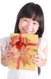 Little girl with christmas gift Stock Photography