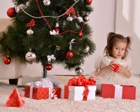 Little girl with Christmas gifts Royalty Free Stock Photos